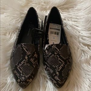 Gray white black memory foam Snake print shoes.